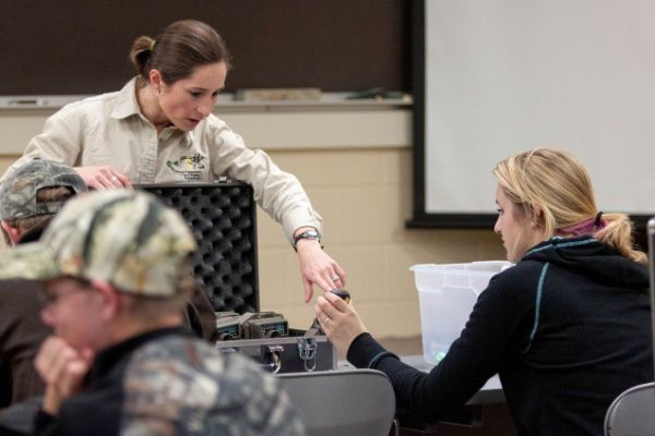 Lucía Corral teaching students at Chadron State College how to use trail cameras. Photo: Teresa Frink