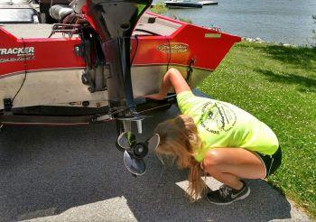 Technician inspecting watercraft