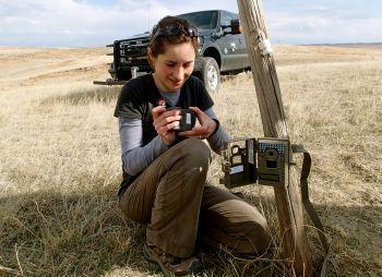 Lucia Corral setting a camera trap ( Photo courtesy of Adela Annis)