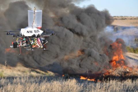 A UAV near a burning field.