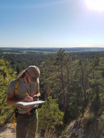 Warren recording data at a sampling location north of Rushville, NE. Photo: Catherine Berrick